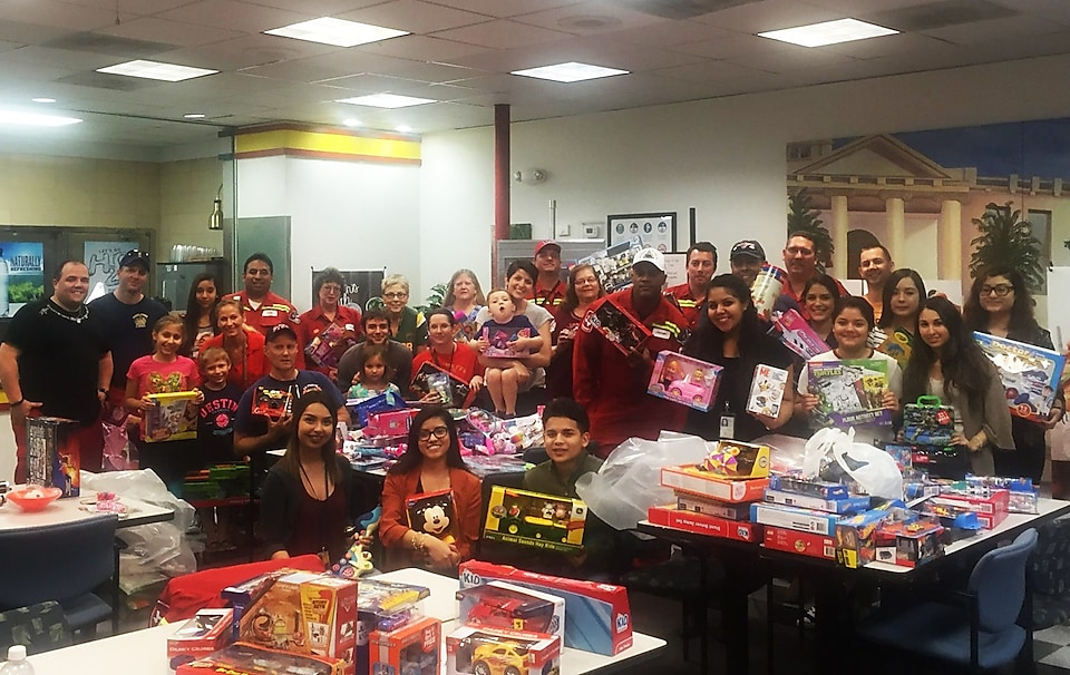 Shell volunteers sort toys collected at Shell Deer Park for the 2015 annual toy drive