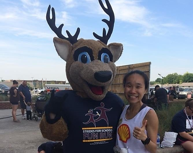 May standing with Deer mask person