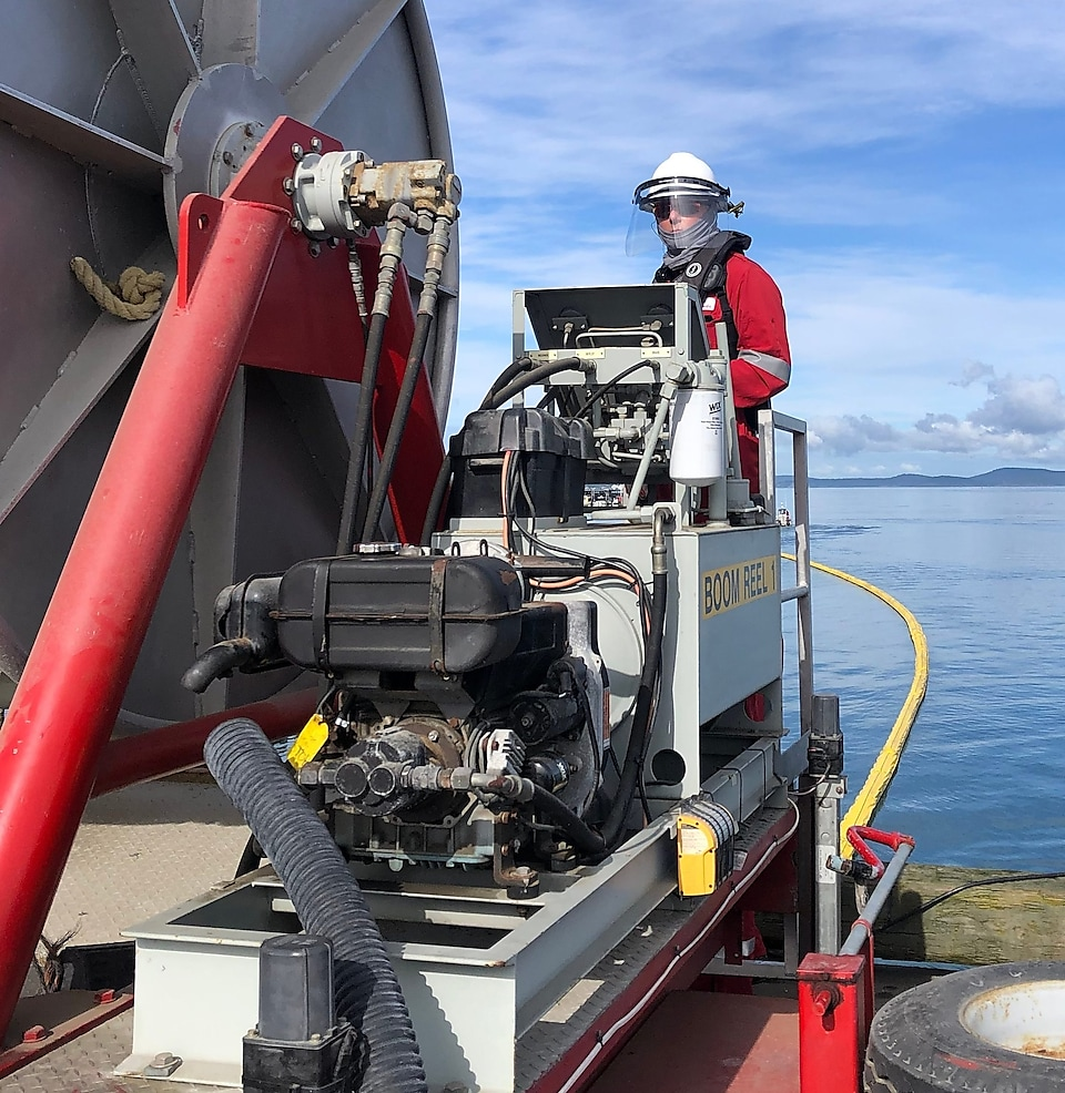 Maintenance supervisor Rick Weynands at work during a summer 2020 boom inspection at Curtis Wharf