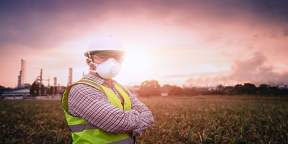 Woman in distribution plant with facemask