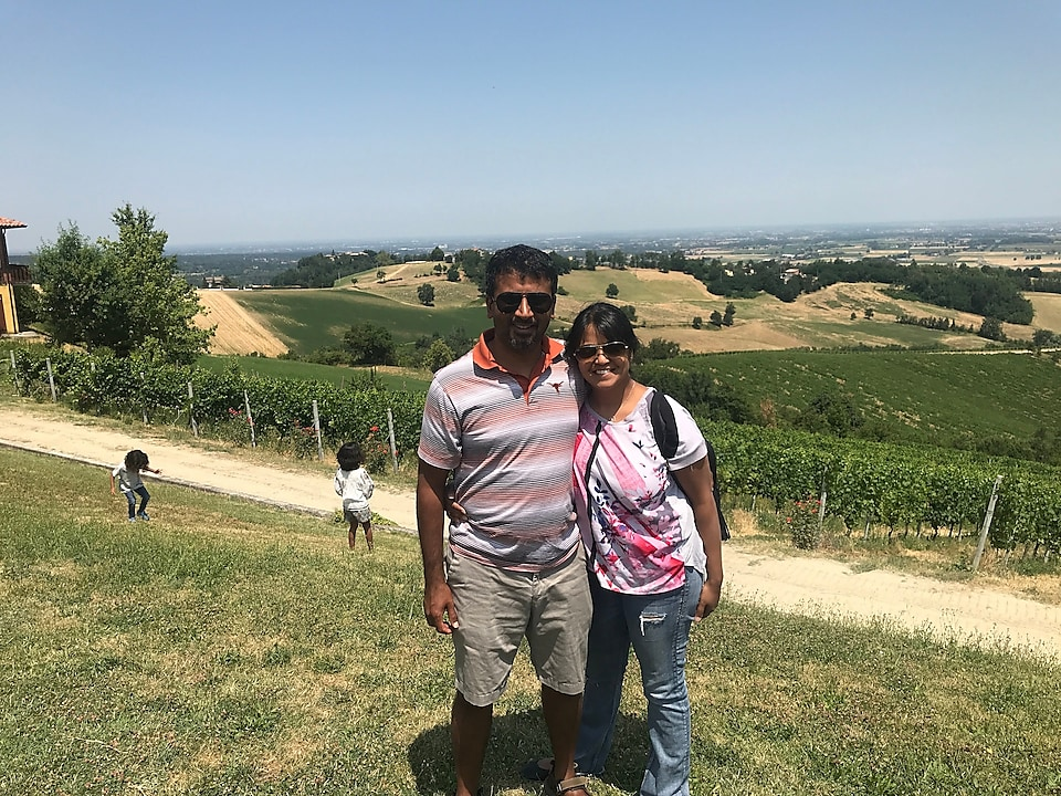 Komal and her husband in Italy