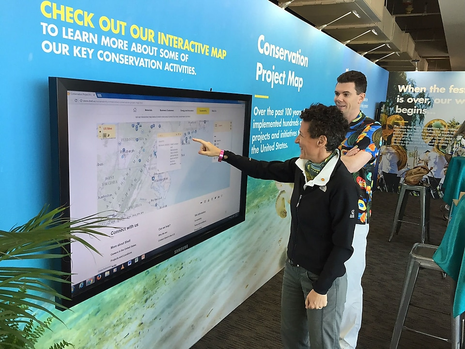 Esme Fantozzi, General Manager of GoM Fit For the Future Delivery, interacting the Conservation Project Map at JazzFest