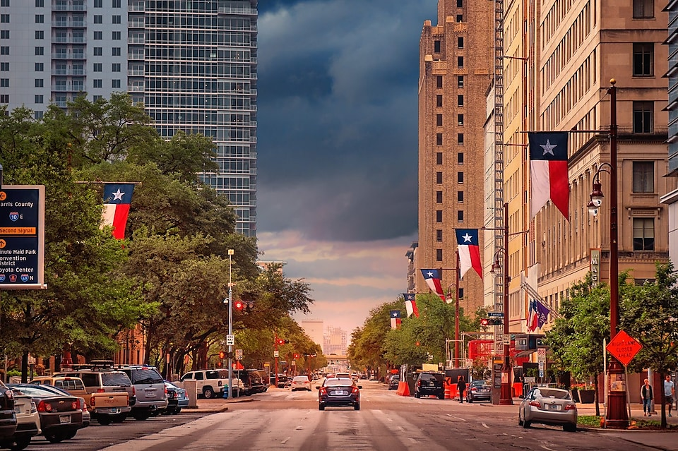 Down town Houston street scape with storm clouds in the distance.